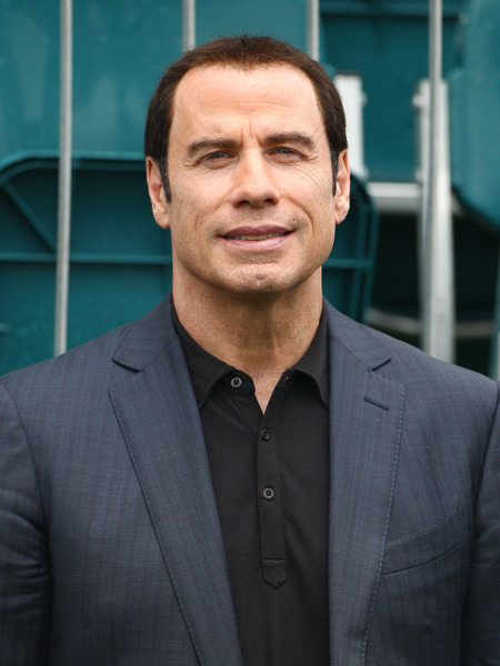 Extra Scoop: John Travolta's Lawyer Declares Victory!