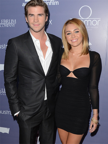 Miley Cyrus' Fiancé Liam Hemsworth Tells Crowd 'We're Married'!