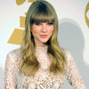 Extra Scoop: Taylor Swift Heads Home from Vacation Alone After Split with Harry Styles