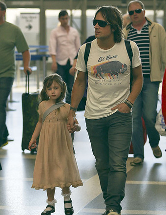 Keith Urban held hands with daughter Sunday Rose as they departed from LAX.