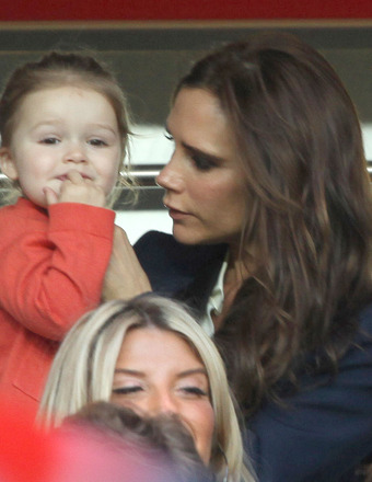 Victoria Beckham and daughter Harper watched David Beckham play his last soccer game in Paris.