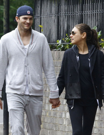 Ashton Kutcher and Mila Kunis were spotted holding hands in London.