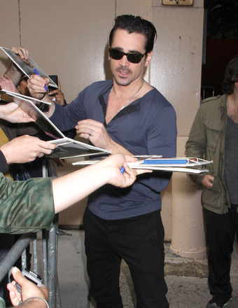 "Colin Farrell signed autographs for fans after appearing on ""Live with Kelly and Michael"" in NYC on Monday."