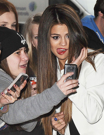 Selena Gomez posed for pictures with fans outside the BBC Radio 1 Studios.