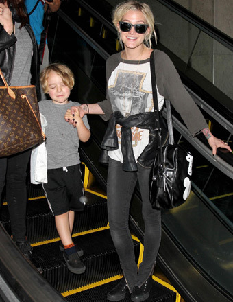 Ashlee Simpson rocked an Ozzy Osbourne t-shirt as she arrived to LAX with son Bronx.