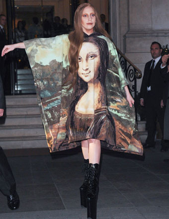 Lady Gaga left London's Langham Hotel wearing a Mona Lisa print dress and towering platform boots on Wednesday.