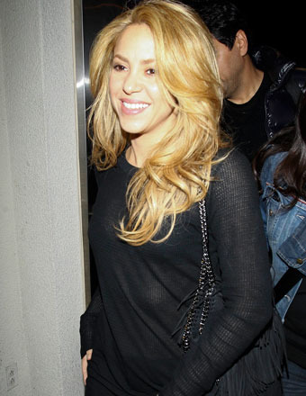 Shakira signed autographs as she arrived to LAX for a flight to London.