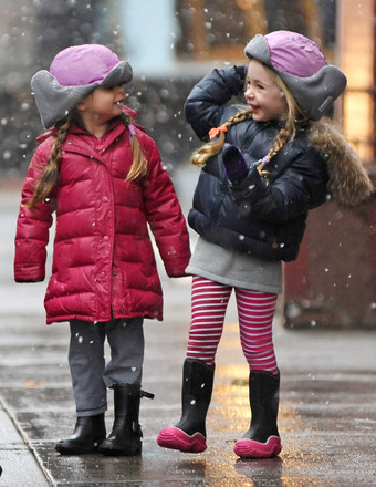 Sarah Jessica Parker's twin daughters play with the snow as they walk to school.