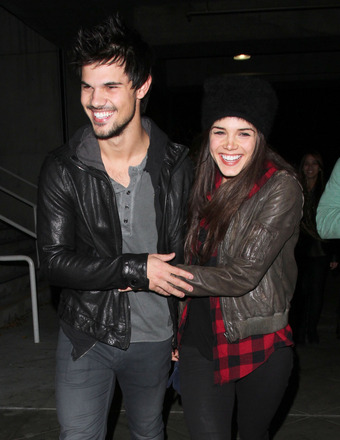 Taylor Lautner took GF Marie Avgeropoulos to the Jay Z concert in Los Angeles on Monday night.