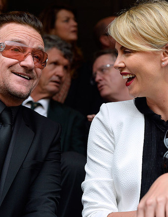 Bono and Charlize Theron attended the memorial service for South Africa former President Nelson Mandela.