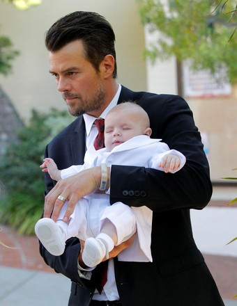Josh Duhamel and Fergie's son Axl was baptized in L.A. on Thursday.