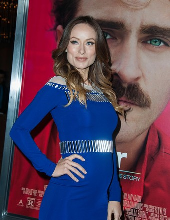 "Mom-to-be Olivia Wilde attended the ""Her"" premiere in L.A. on Thursday."